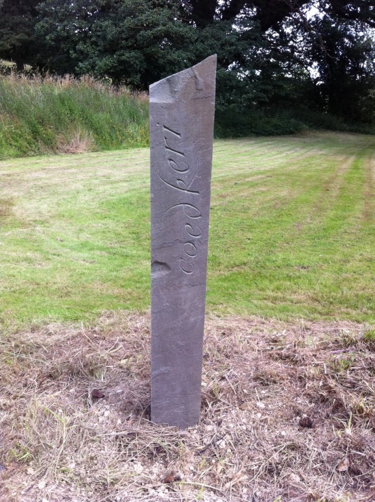 "A standing stone with ""Coed Keri"" inscribed"